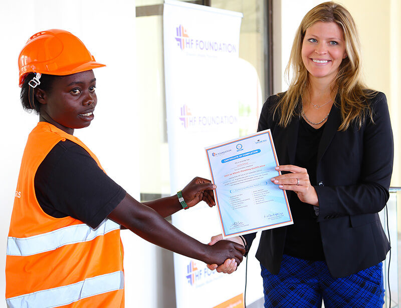 Global Communities Country Director, Kimberly Tilock presents a certificate to one the students during the Housing Finance Graduation Ceremony.