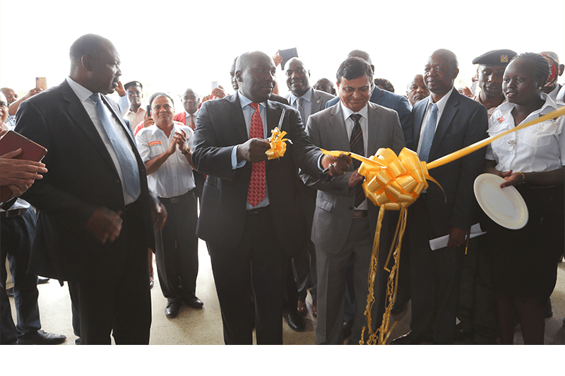 His Excellency the Governor of Kisumu, Hon Jack Raguma (left), State Department of industry and Enterprise Development - Principle Secretary, Julius Korir (centre) and Crown Paints CEO, Rakesh Rao cut a ribbon to officially open the new Crown Paints Factory in Kisumu City.