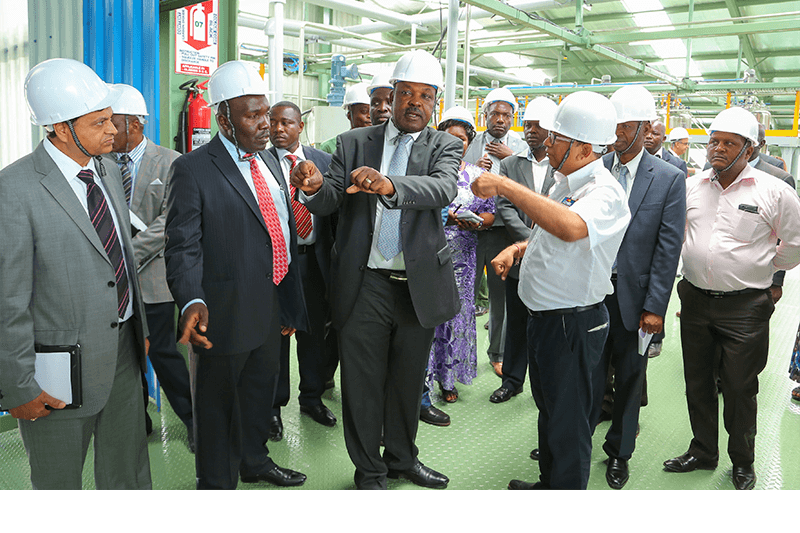From left: Crown Paints CEO, Rakesh Rao, State Department of industry and Enterprise Development - Principle Secretary, Julius Korir, His Excellency the Governor of Kisumu, Hon Jack Raguma (second right) and the factory Head, Shailesh Patel.