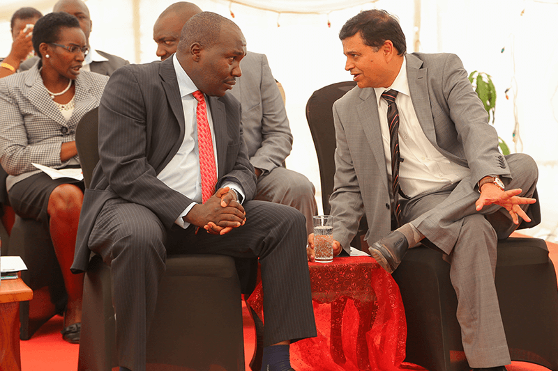 Crown Paints CEO, Rakesh Rao interacts with State Department of industry and Enterprise Development - Principle Secretary, Julius Korir, moments after the official opening of a new Crown Paints factory in Kisumu.