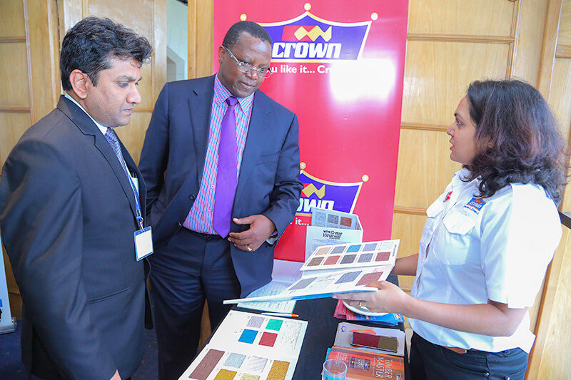 Crown Paints, Head of Sales, Rakesh Ranjan (left) and Crown Paints Marketing Officer, Roshni Vora (right) take Suraya Property Group Limited- CEO, Peter Muraya through a colour chart.