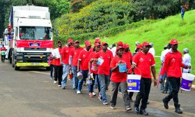 Crown Paints Factory staff marching past the Uhuru Park dias during this year's Labour Day celebrations. Crown Paints staff participated in the procession march during the International Workers' Day, which commemorates the historic struggle of working people thought the world.